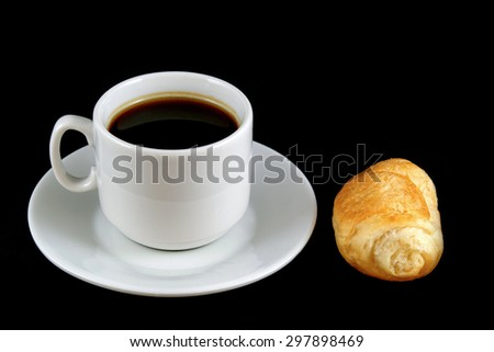 Cup of coffee with a croissant  isolated - stock photo