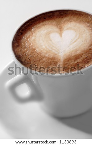 Cup of coffee with a heart - stock photo