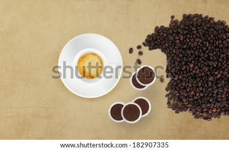 cup of coffee with beans, coffee pods on marble table - stock photo