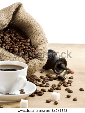 cup of coffee with beans in sack burlap - stock photo