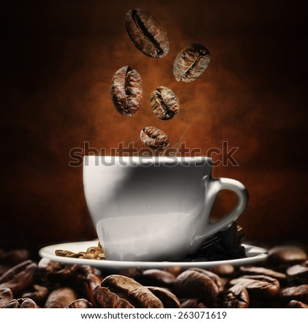 Cup of coffee with beans on dark background - stock photo