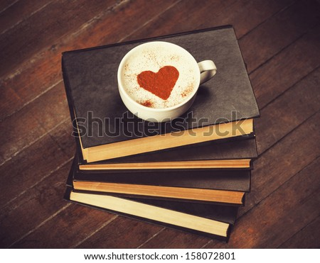 Cup of coffee with books - stock photo