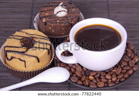 cup of coffee with cakes on a bamboo mat