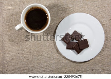Cup of coffee with chocolate on the saucer - stock photo