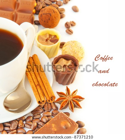 Cup of coffee with chocolates, coffee grains with cinnamon and an anise