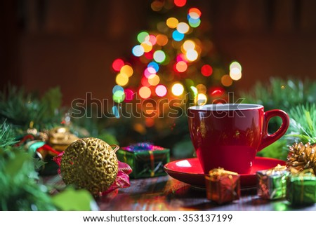 Cup of coffee with Christmas decorations - stock photo