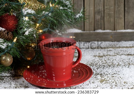 Cup of coffee with Christmas decorations on a wood background - stock photo