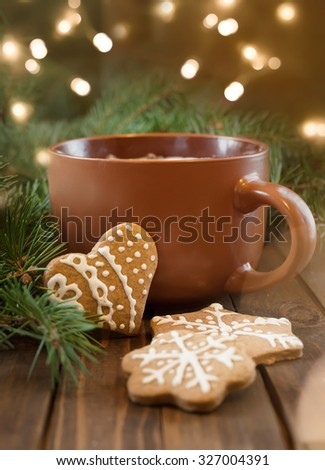 Cup of coffee with Christmas sweetness - stock photo