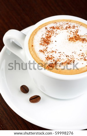 cup of coffee with cinnamon - stock photo