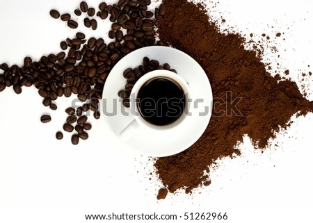 Cup of coffee with coffee beans and ground coffee