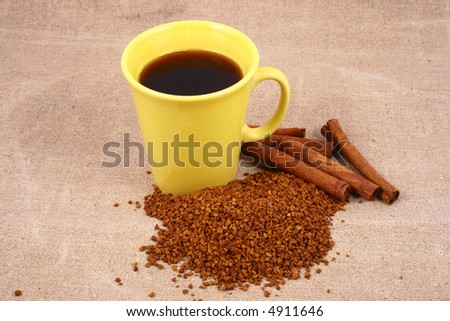 cup of coffee with coffee grain