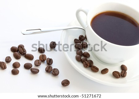 cup of coffee with coffee grain - stock photo