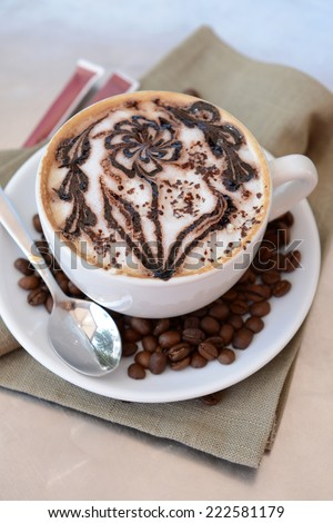 Cup of coffee with cute drawing on table, close up - stock photo