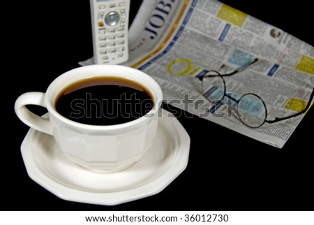 cup of coffee with employment ads - stock photo