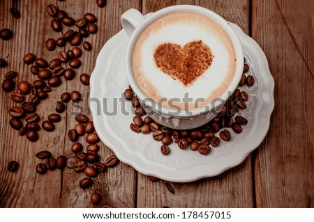 Cup of coffee with heart on foam - stock photo