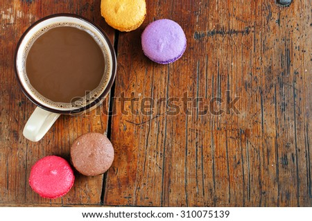 Cup Of Coffee With Milk And Macarons on wooden background - stock photo