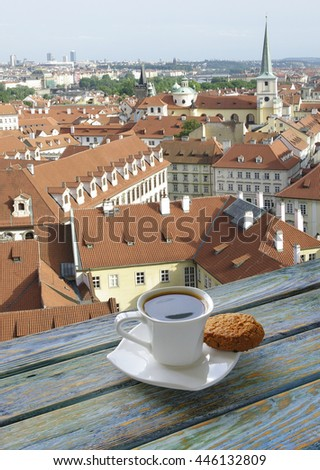 Cup of coffee with Prague view