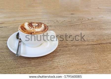 cup of coffee with rose coffee art on top - stock photo