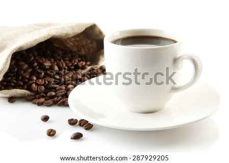 Cup of coffee with saucer with bag with coffee beans isolated on white - stock photo