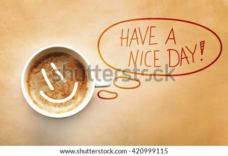 Cup of coffee with smile and inspiration quote - stock photo