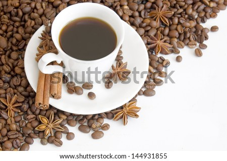 Cup of coffee with spice and coffee beans isolated on white background - stock photo