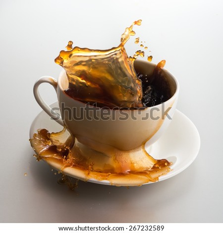 Cup of coffee with splash on background - stock photo