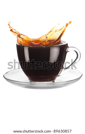 Cup of coffee with splash on white background - stock photo