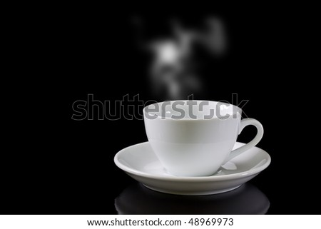 cup of coffee with steam on black background - stock photo