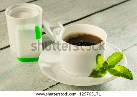 Cup of coffee with stevia sweetener tabs or in powder form - stock photo
