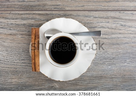 Cup of coffee with stick of cinnamon. With teaspoon - stock photo