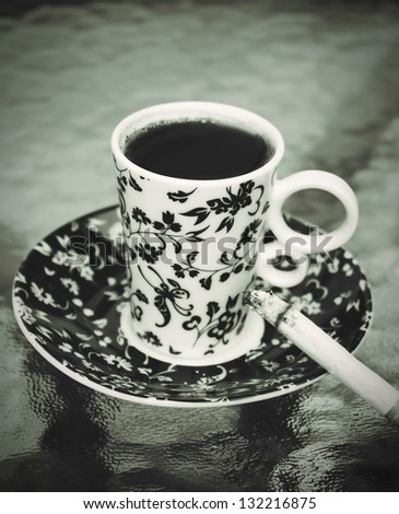 Cup of coffee with the cigarette.toned picture - stock photo