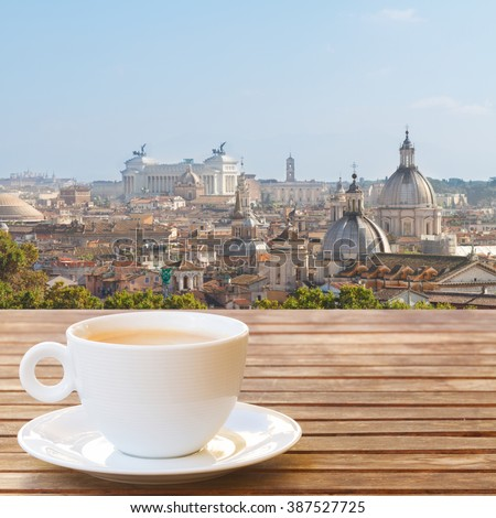 Cup of coffee with view of Rome skyline, Italy - stock photo