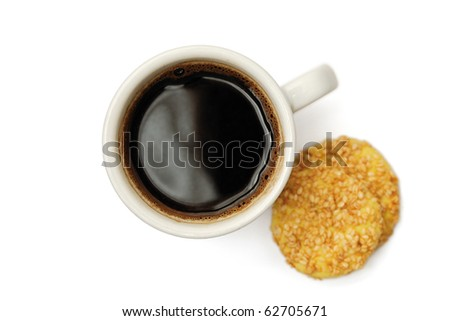 Cup of delicious coffee and sesame biscuits isolated on white background - stock photo