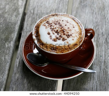 Cup of delicious hot cafe latte coffee. - stock photo