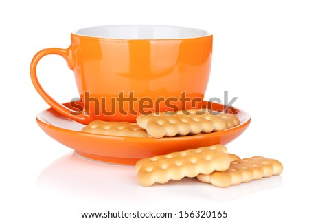 Cup of drink with crackers. Isolated on white background - stock photo