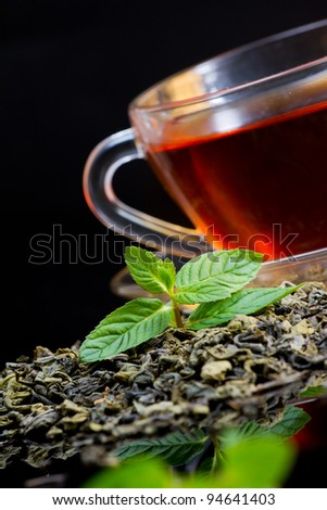 Cup of english green tea with mint - stock photo