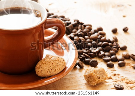 Cup of espresso and biscotti - stock photo
