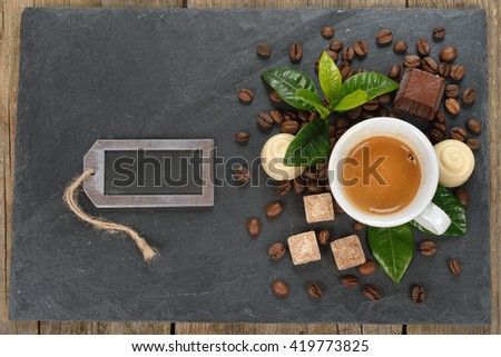 Cup of espresso and chocolate on a black background - stock photo