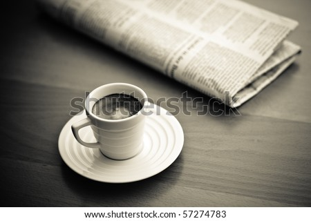 cup of Espresso and newspaper, vintage monochrome - stock photo