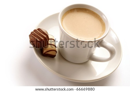 Cup of espresso coffee and chocolate candies