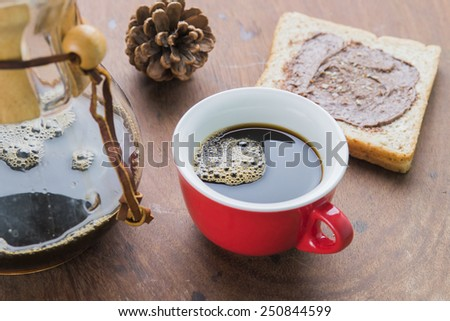 Cup of espresso coffee making by homemade with chocolate bread. - stock photo