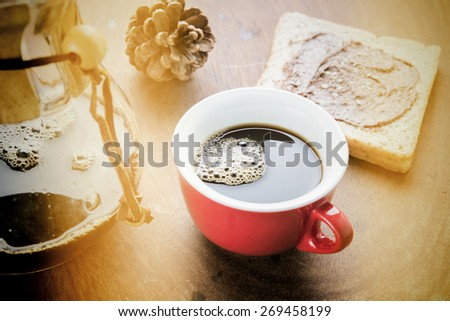 Cup of espresso coffee making by homemade with chocolate bread. Photo in vintage color tone style. - stock photo