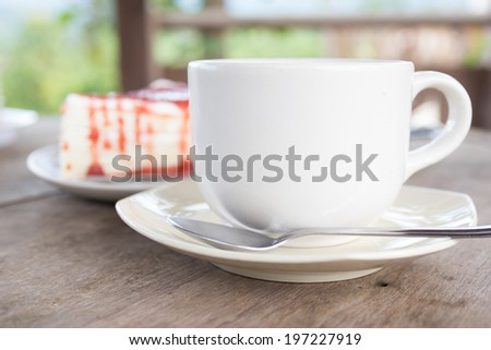 Cup of espresso coffee with cake - stock photo