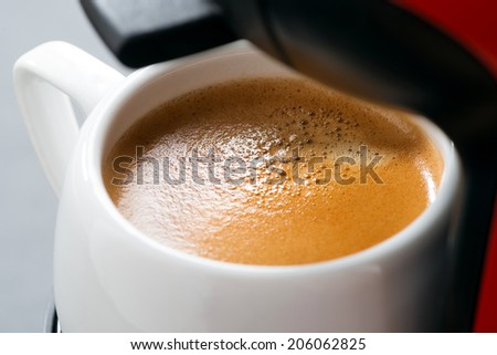cup of espresso in the coffee machine, selective focus, close-up, horizontal - stock photo