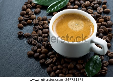 cup of espresso on coffee beans background, horizontal, top view - stock photo