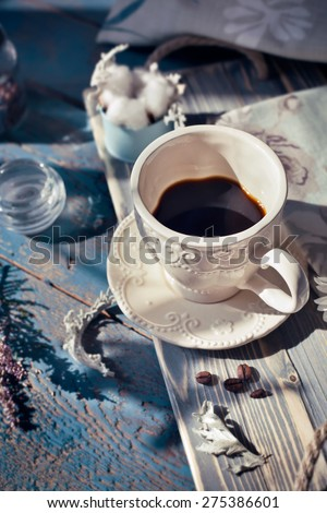 Cup of espresso set on a wooden table, natural light setting, toned photo - stock photo