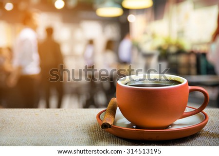 cup of espresso with blur people in coffee shop background - stock photo