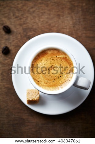 Cup of espresso with brown sugar - stock photo