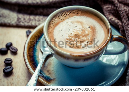 Cup of espresso with coffee beans. Coffee Espresso. Cup Of Coffee - stock photo