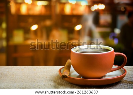 Cup of espresso with coffee shop background - stock photo